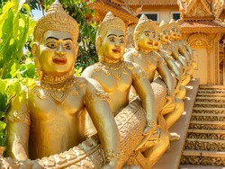 Temple guardians at Wat Kean Kliang, a Buddhist temple in Phnom Penh, Cambodia, located between the Tonle Sap and Mekong rivers.