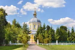 Temple in honor of the miracle of the Archangel Michael in Khonekh. The city of Novozybkov. Russia. Church with a high three-tiered bell tower. Ancient Russian style. Dome with a cross.