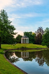 Temple in the parc de l'orangerie and its reflection in the lake of l'orangerie