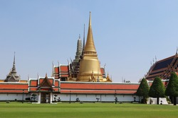Temple of Emerald Buddha (Wat Phra Kaew) in Bangkok, Thailand  isolated on blue sky and white cloud background closeup. Is the grand palace of general tourists.