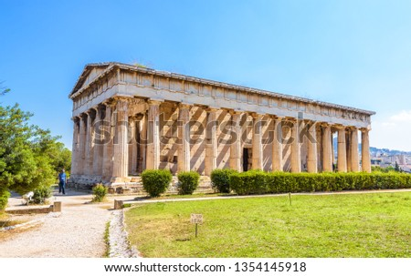 Temple of Hephaestus in Athens, Greece. It is an old famous landmark of Athens. Sunny view of Ancient Greek ruins in the Athens center. Nice panorama of the great monument of antique Athens in summer.