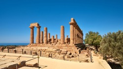 Temple of Juno, Temple of Hera Lacinia, Valley of the Temples, Agrigento, Sicily, Italy. Panoramic banner image taken on bright day, blue sky. Selective focus.