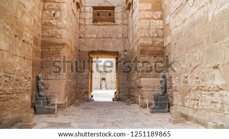 Temple of Medinet Habu. Egypt, Luxor. The Mortuary Temple of Ramesses III at Medinet Habu is an important New Kingdom period structure in the West Bank of Luxor in Egypt #1251189865