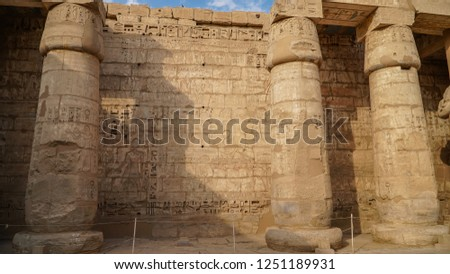 Temple of Medinet Habu. Egypt, Luxor. The Mortuary Temple of Ramesses III at Medinet Habu is an important New Kingdom period structure in the West Bank of Luxor in Egypt #1251189931