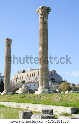Temple of Olympian Zeus, Athens, Greece. It is a great landmark of Athens. Huge Ancient Greek ruins overlooking Acropolis of Athens. People visit the remains of the antique Athens city.