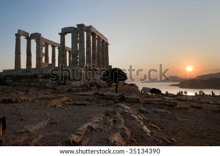 temple of Poseidon on coast of cape Sounion at the sunset
