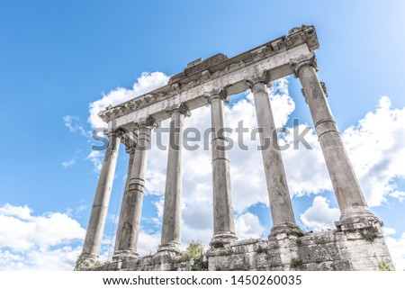 Temple of Saturn - ruins with old historical columns. Roman Forum archeological site, Rome, Italy. #1450260035
