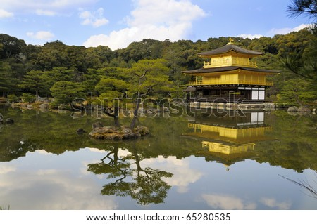 Temple of the Golden Pavilion, also known as Kinkaku-ji or Rokuon-ji, reflected in a lake. Northern Kyoto, Japan, picture taken early April