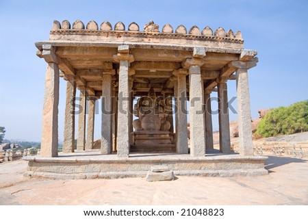 Temple on the sacred Hemakuta hill and statue of Ganesha, Hampi, Karnataka state, India