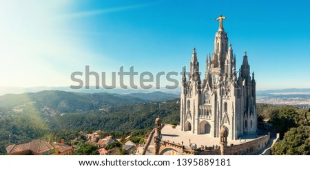Temple Sacred Heart of Jesus on Mount Tibidabo on background of blue sky, Barcelona, ​​Spain. #1395889181
