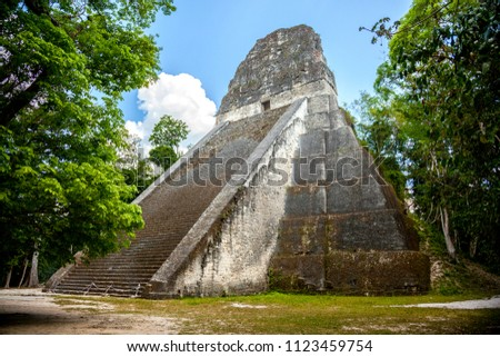 Temple V stands south of the Central Acropolis and is a mortuary pyramid. It has been dated AD 700, in the Late Classic period of the Mayas. is the second tallest structure in Tikal, Guatemala. #1123459754