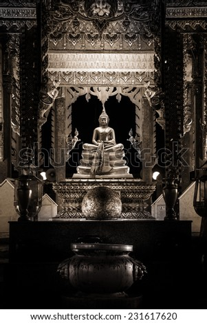 Stock Photo temple with Buddha statue is piety of Buddhist.Edite sepia tone.
