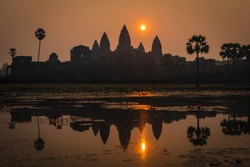 Temples of Angkor areal, with nature flooding on the constructions.