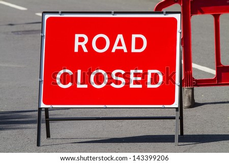 Temporary red road closed sign