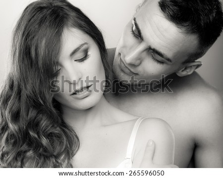 Temptation woman and man. Passionate young people in love. Couple in the passion. Black & white photo