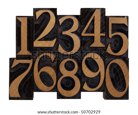 ten arabic numerals 0-9 in vintage wood letterpress blocks stained by black ink, flipped horizontally, isolated on white with clipping path
