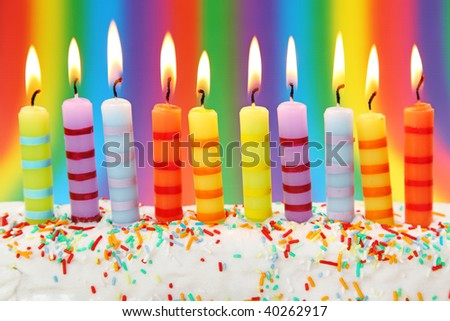 Ten birthday candles on pink background