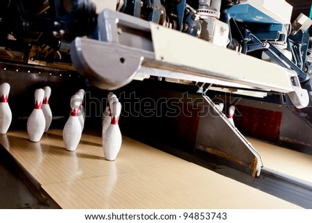 Ten bowling pins at the end of the alley