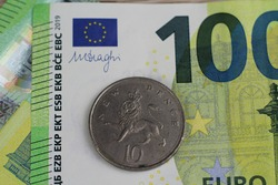 ten britisch pence on a one hundred euro bank note