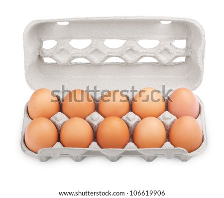 Ten brown eggs in a carton package isolated on white