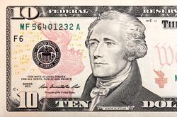 Ten dollars bill fragment of U.S. money in macro.