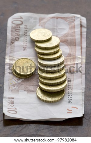 ten euro notes with euro coins