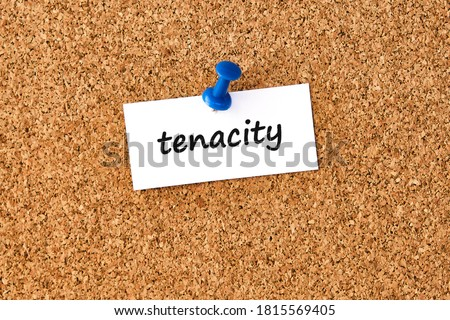 Tenacity. Word written on a piece of paper or note, cork board background. Stock photo ©