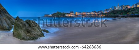 Tenby, Wales Harbor Evening Panorama - lights and colorful buildings around beach of Tenby (Dinbych-y-Pysgod) in South West Wales