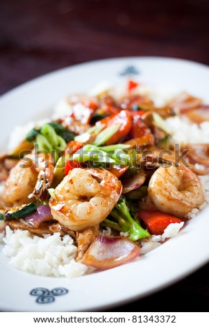 Tender breast of chicken and shrimp are quick fried with a medley of seasoned vegetables in teriyaki sauce. Served over a bed of rice.