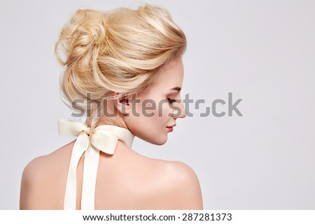 Tender fashion portrait of beautiful gentle young blond woman with silk bow on the neck cosmetics for body face hair pure natural beauty, organic and diet harmony, makeup