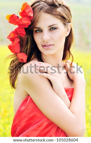 tender girl with poppies in her hair