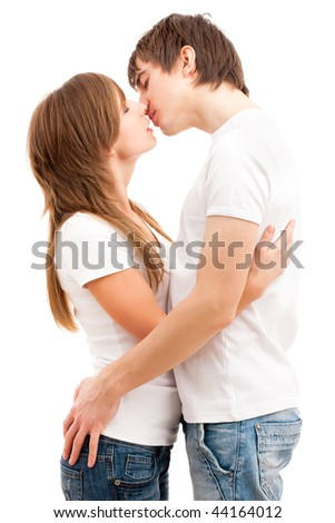 Tender kissing of a young happy couple. Isolated over white