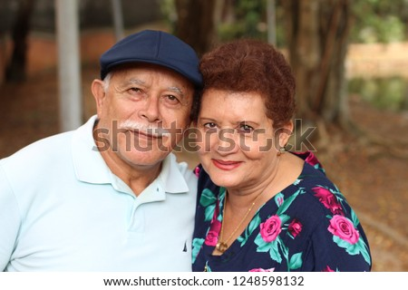 Tender older ethnic couple candid