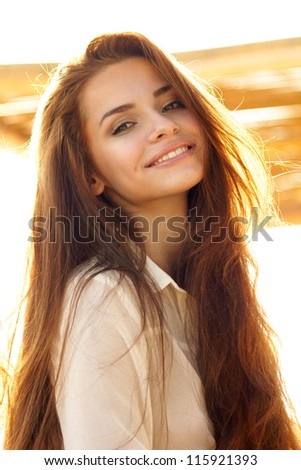 tender outdoor portrait of young attractive, tender, sensual and elegant woman