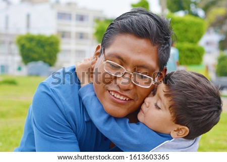 Tender portrait of native american man with his little son in the park. Photo stock ©