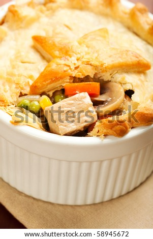 Tender Turkey with carrot, mushroom, peas, and corn inside of a flaky crust