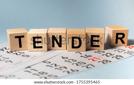 TENDER word on cube block on calendar sheets. date of tender concept Stockfoto ©