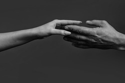 Tenderness and forgiveness. Hand holding another hand. Tenderness woman. Concept of caring and tenderness. Male and female hands touch each other