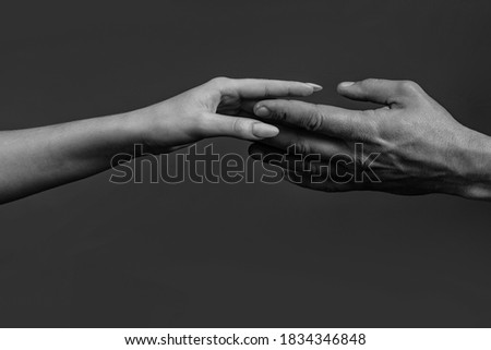 Photo of  Tenderness and forgiveness. Hand holding another hand. Tenderness woman. Concept of caring and tenderness. Male and female hands touch each other