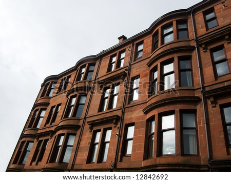 Tenement Facade - residential middle class property exterior with bay windows in Glasgow, Scotland, UK