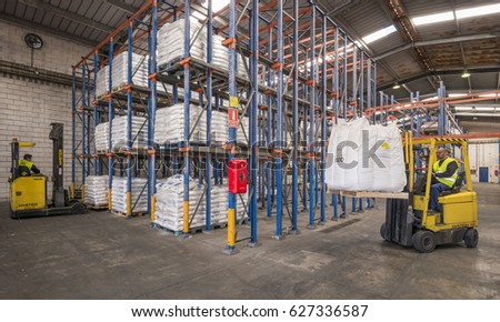 TENERIFE, CANARY ISLANDS - FEBRUARY 24, 2016: Forklifts, working in a warehouse of the industrial district in South Coast #627336587