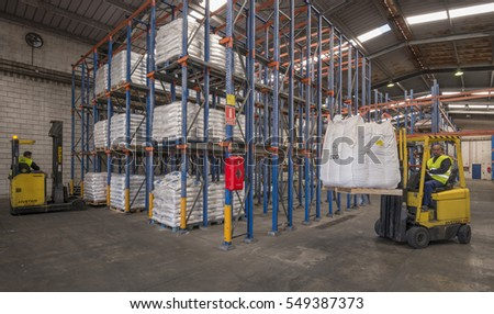 TENERIFE, CANARY ISLANDS - JULY 14, 2013: Movement of goods, with mechanical elevators, in some warehouses of the industrial zone #549387373