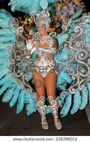 TENERIFE, FEBRUARY 17: Carnival groups and costumed characters, parade through the streets of the city. FEBRUARY 17, 2015, Tenerife (Canary Islands) Spain.