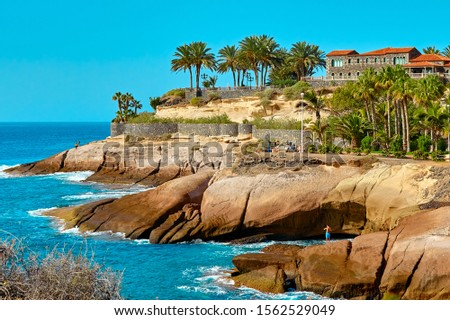Tenerife island and ocean on a summer day landscape. Amazing rocks view. Seaside resort.