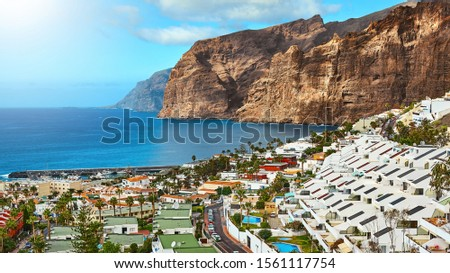 Tenerife island on a summer day panoramic landscape. Amazing aerial view on ocean and rocks. Seaside resort.
