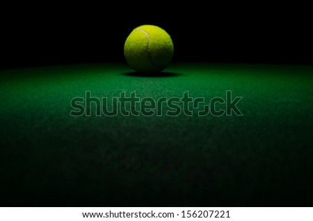 Tennis background - low key centered ball with green surface