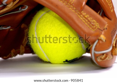 Tennis ball and glove for game in the baseball.