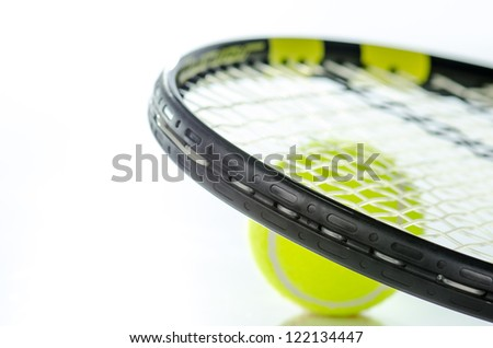 Tennis ball and racket against a white background