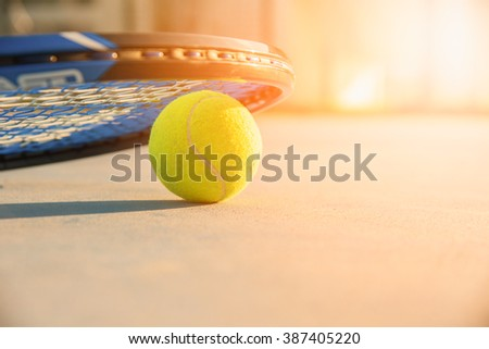 Tennis Ball and Racket. green color tennis ball. single tennis ball. tennis ball from Thailand. tennis ball vivid tone. the new tennis ball. beautiful tennis ball. Tennis ball on a tennis court