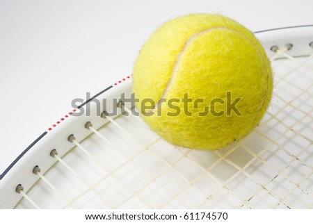 tennis ball and racket in  macro mode